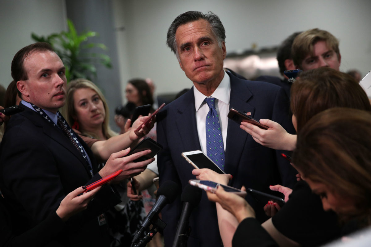 Mitt Romney surrounded by cell phones