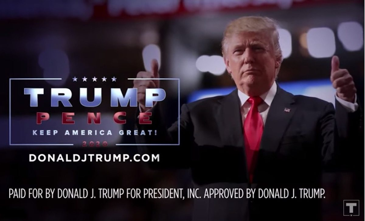 Donald Trump gives double thumbs up in a campaign ad.
