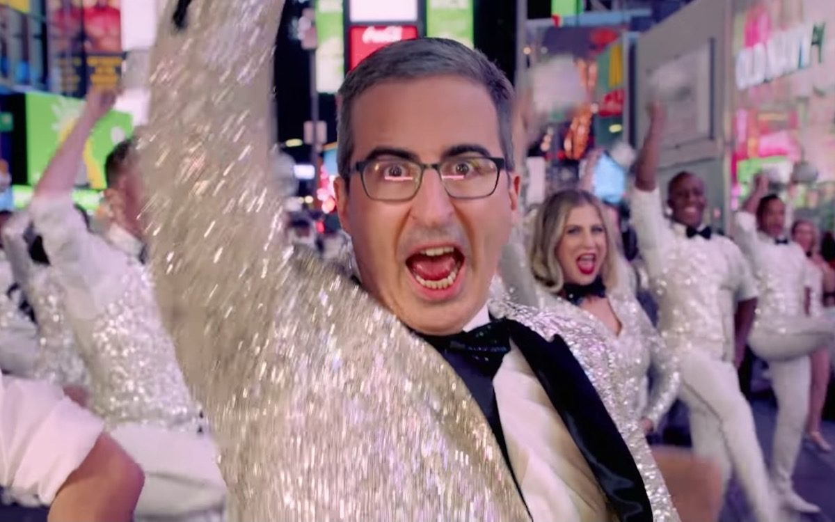 John Oliver sings and dances in a sparkly tuxedo.