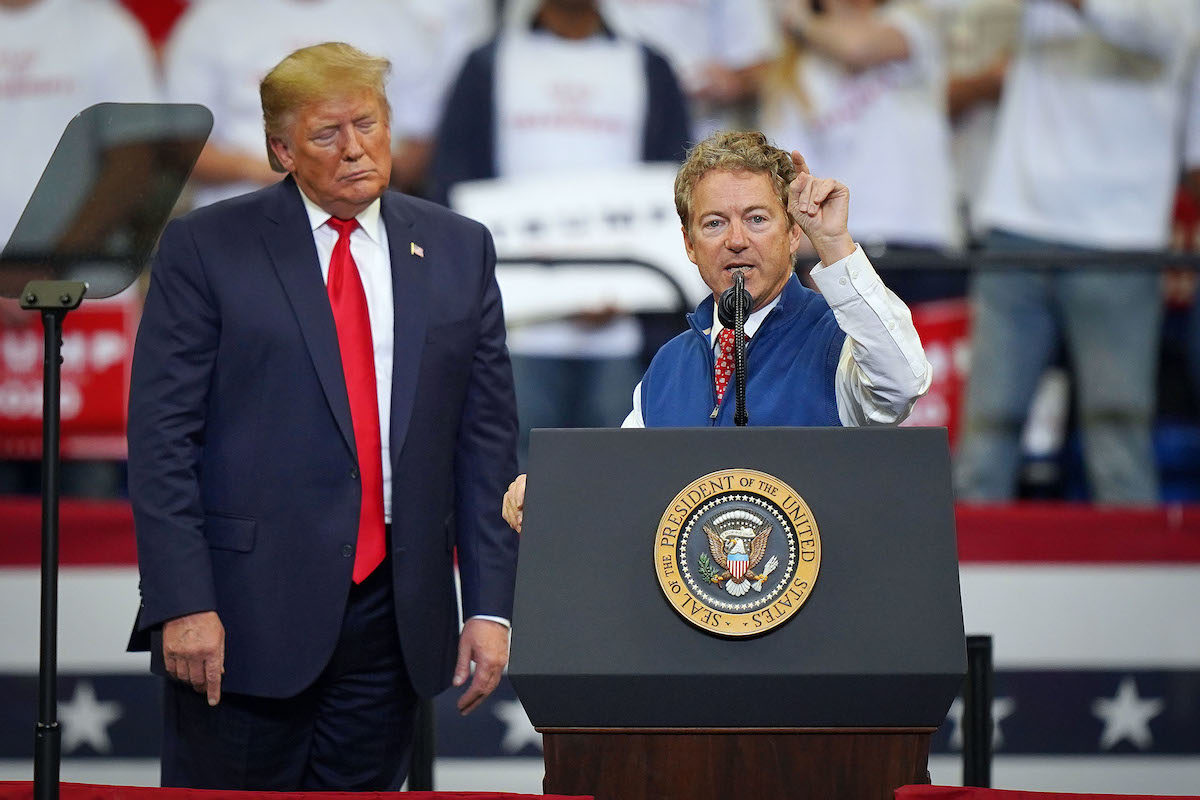 Rand Paul rants from the stage at a rally next to Donald Trump