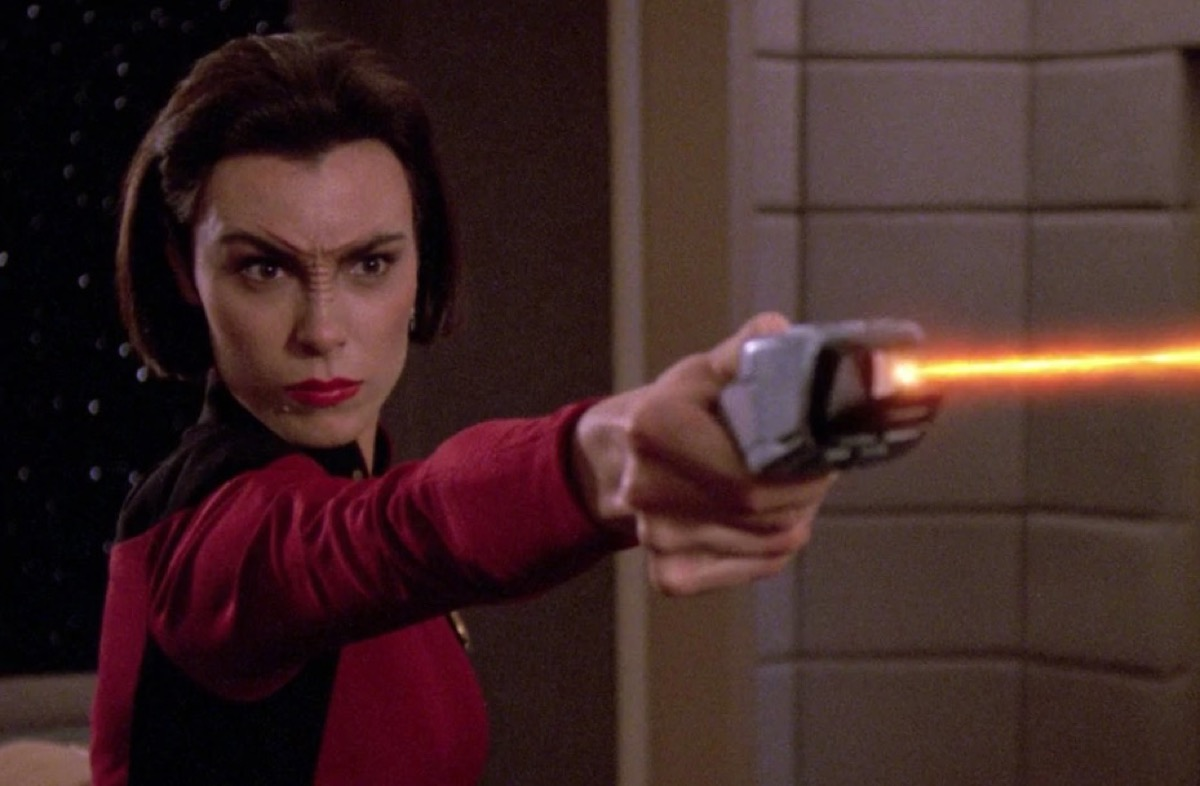 Ro Laren firing a phaser in Star Trek: The Next Generation.