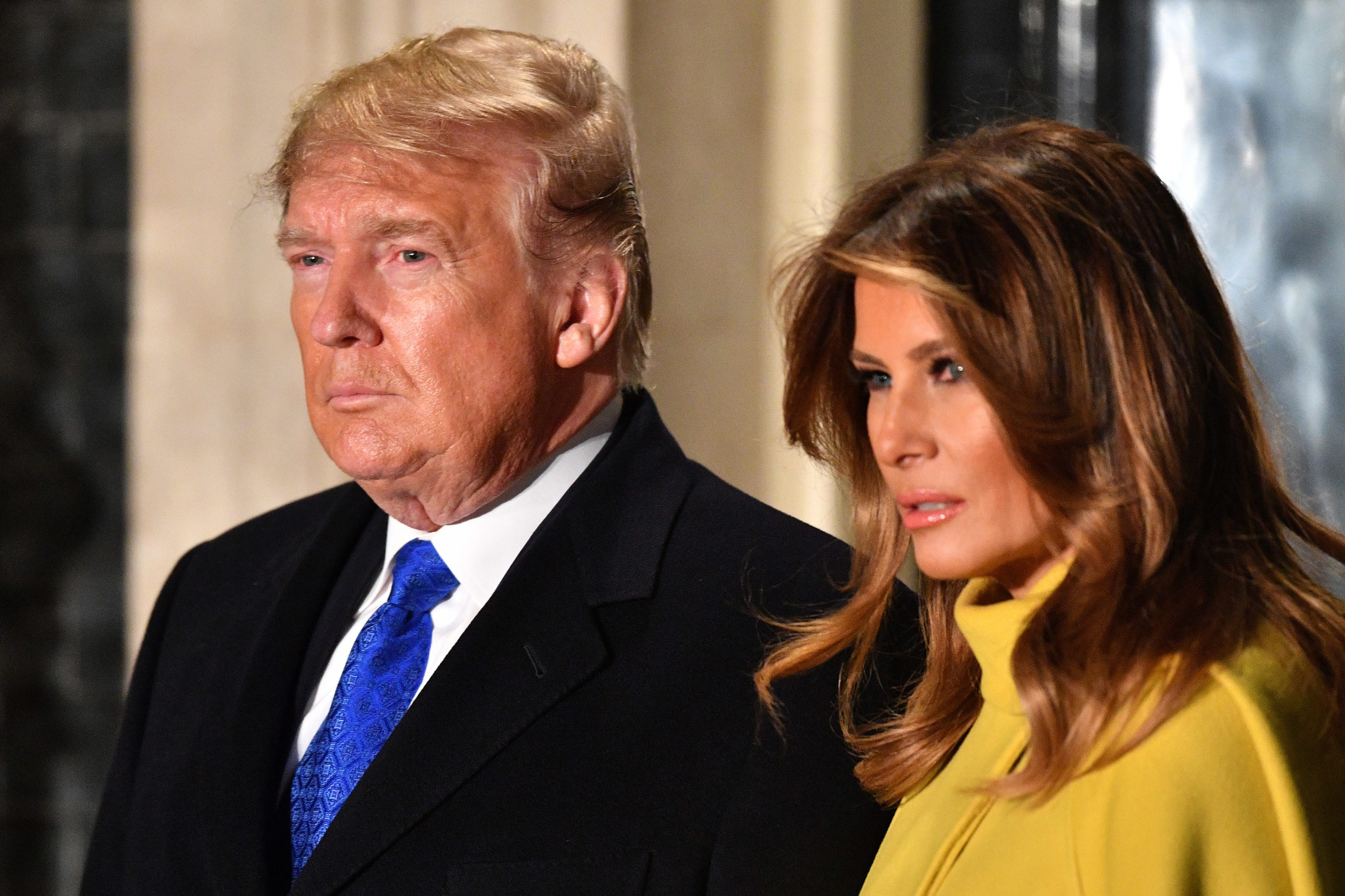 Donald and Melania Trump look very serious.