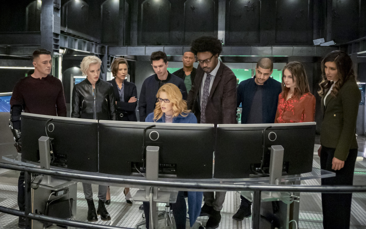"""Arrow -- """"Fadeout"""" -- Image Number: AR810B_0438b.jpg -- Pictured (L-R): Colton Haynes as Roy Harper, Katie Cassidy as Laurel Lance/Black Siren, Audrey Marie Anderson as Lyla Michaels, Joe Dinicol as Rory Regan/Ragman, Emily Bett Rickards as Felicity Smoak, David Ramsey as John Diggle/Spartan, Echo Kellum as Curtis Holt/Mr. Terrific, Rick Gonzalez as Rene Ramirez/Wild Dog, Willa Holland as Thea Queen and Juliana Harkavy as Dinah Drake/Black Canary -- Photo: Colin Bentley/The CW -- © 2020 The CW Network, LLC. All Rights Reserved."""