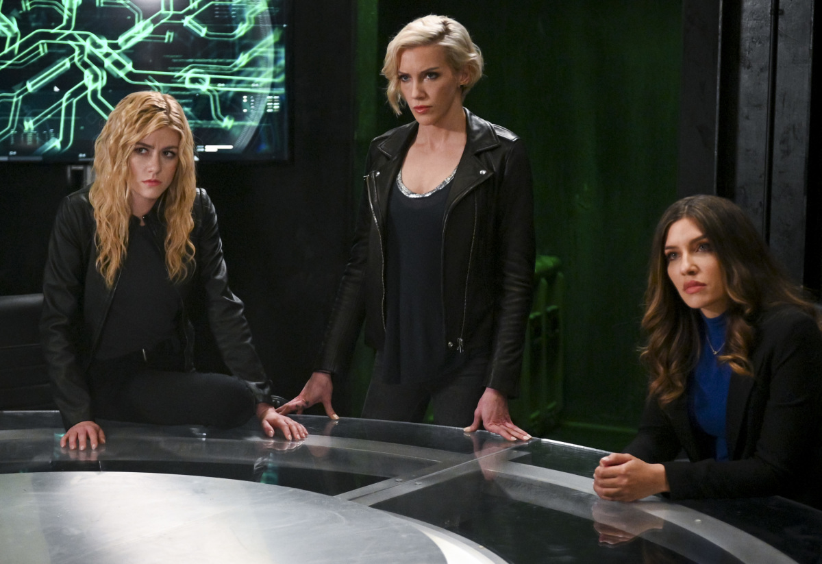 "Arrow -- ""Present Tense"" -- Image Number: AR804b_0437b.jpg -- Pictured (L-R): Katherine McNamara as Mia, Katie Cassidy as Laurel Lance/Black Siren and Juliana Harkavy as Dinah Drake/Black Canary -- Photo: Sergei Bachlakov/The CW -- © 2019 The CW Network, LLC. All Rights Reserved."