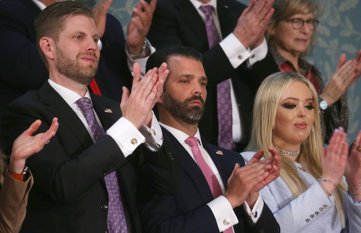 Eric Trump (L), Donald Trump Jr, and Tiffany Trump clap during the State of the Union address