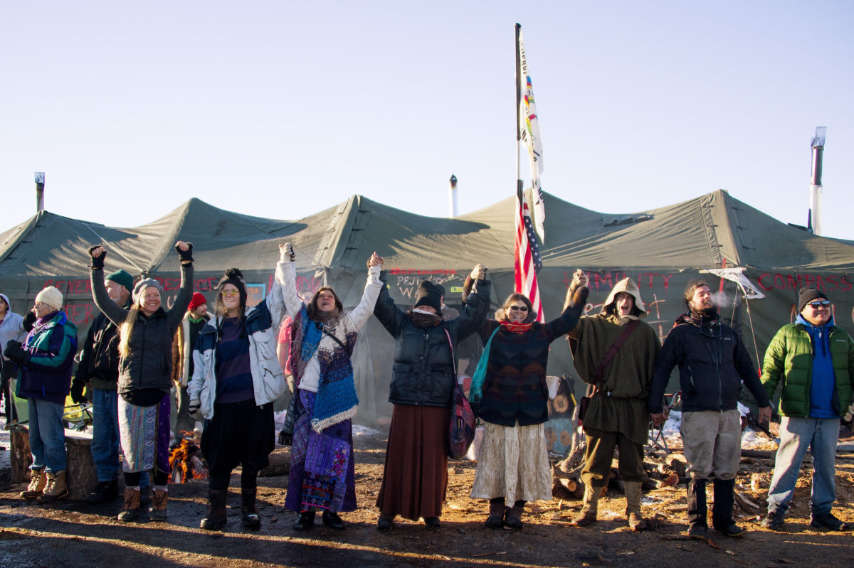Activists celebrate at Oceti Sakowin Camp on the edge of the Standing Rock Sioux Reservation on December 4, 2016 outside Cannon Ball, North Dakota. The Army Corps of Engineers told Standing Rock Sioux Chairman Archambault Sunday that the current route for the Dakota Access pipeline will be denied. / AFP / JIM WATSON (Photo credit should read JIM WATSON/AFP via Getty Images)