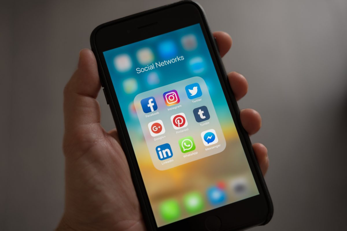 iphone screen with social media aps.