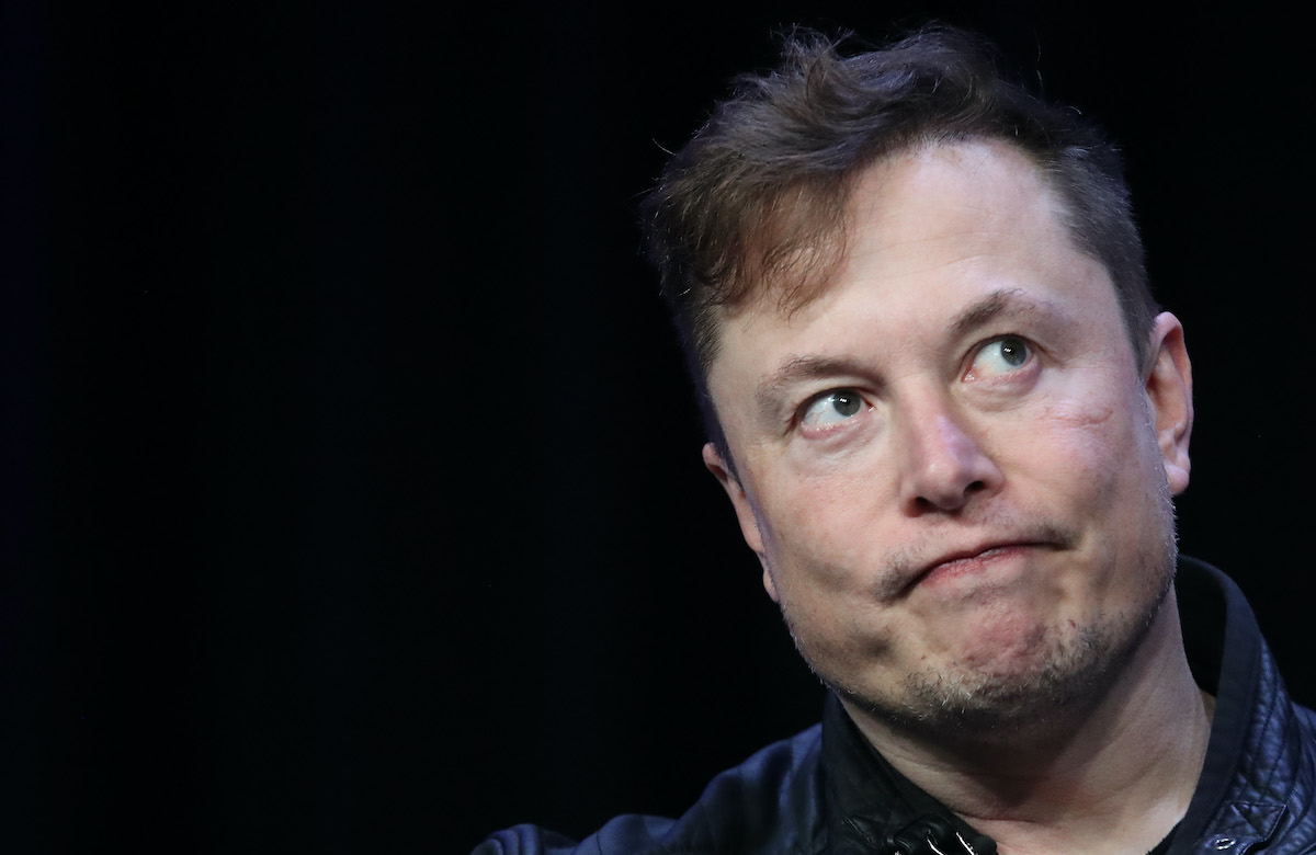 Elon Musk makes a frowny face.