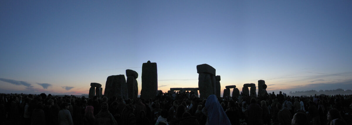 pagans gather before stonehenge on the summer solstice