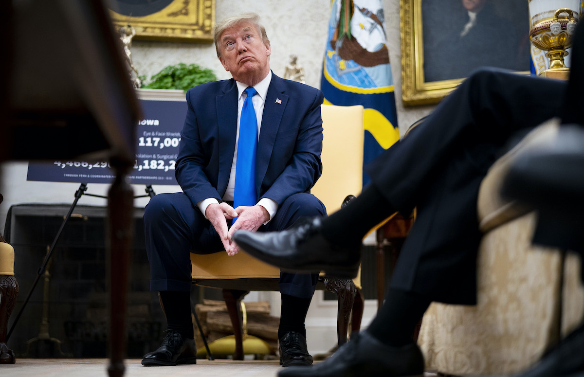 Donald Trump looks confused in an Oval Office meeting.