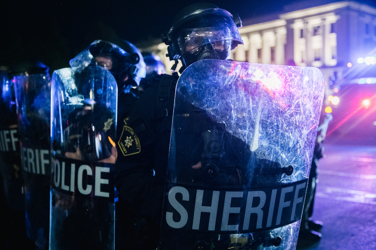 A row of police officers holding shields in Kenosha, Wisconsin.