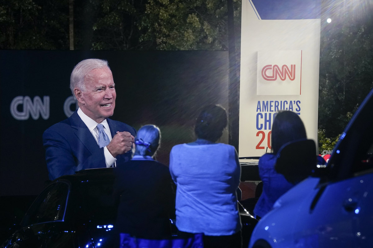 Joe Biden is projected onto a drive-in screen for CNN's town hall event.