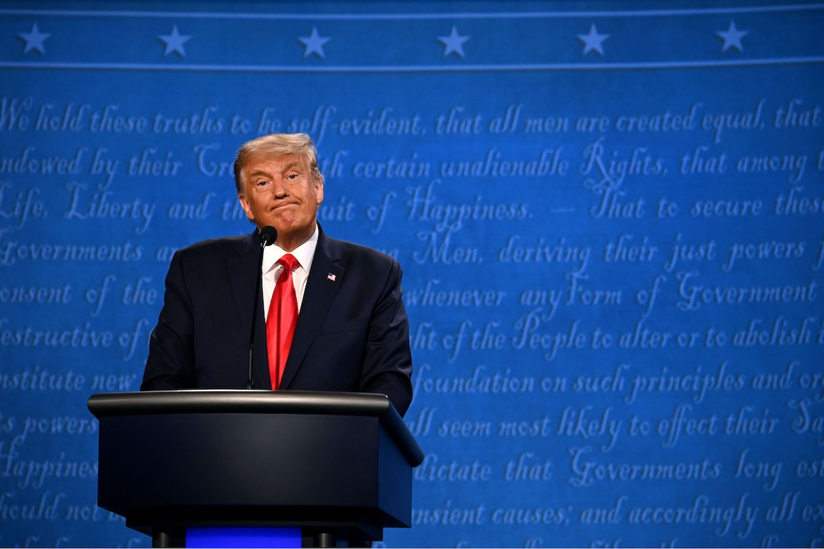 Donald Trump reacts during the final presidential debate