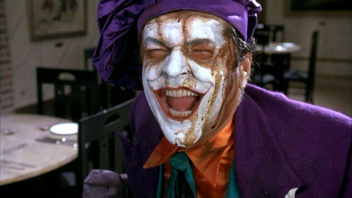 Jack Nicholson's Joker with makeup running down his face.