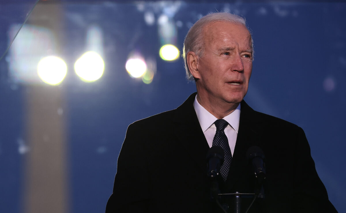 WASHINGTON, DC - JANUARY 19: U.S. President-elect Joe Biden delivers brief remarks during a memorial service to honor the nearly 400,000 American victims of the coronavirus pandemic at the Reflecting Pool in front of the Lincoln Memorial January 19, 2021 in Washington, DC. As the nation's capital has become a fortress city of roadblocks, barricades and 20,000 National Guard troops due to heightened security around Biden's inauguration, 200,000 small flags were installed on the National Mall to honor the nearly 400,000 Americans killed by COVID-19. (Photo by Chip Somodevilla/Getty Images)