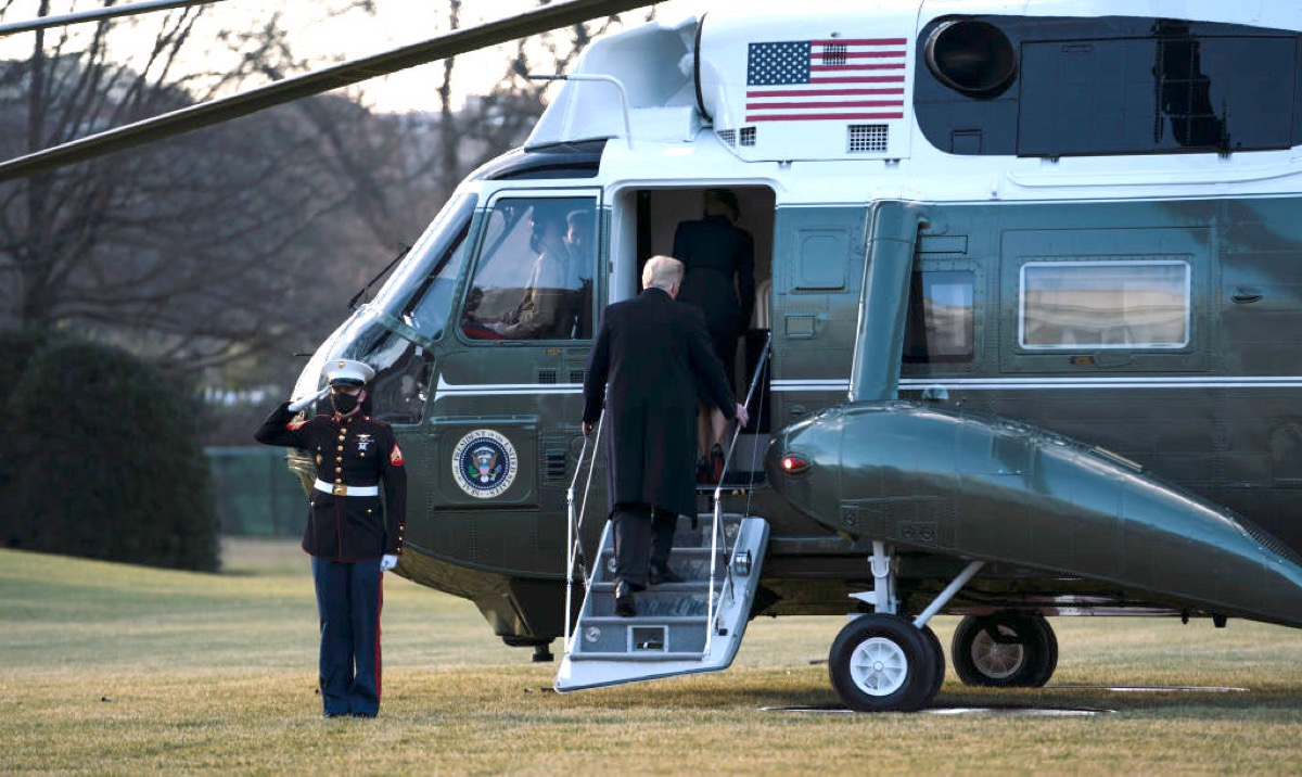 WASHINGTON, DC - JANUARY 20: President Donald Trump and first lady Melania Trump board Marine One as they depart the White House on January 20, 2021 in Washington, DC. President Trump is making his scheduled departure from the White House for Florida, several hours ahead of the inauguration ceremony for his successor Joe Biden, making him the first president in more than 150 years to refuse to attend the inauguration. (Photo by Eric Thayer/Getty Images)