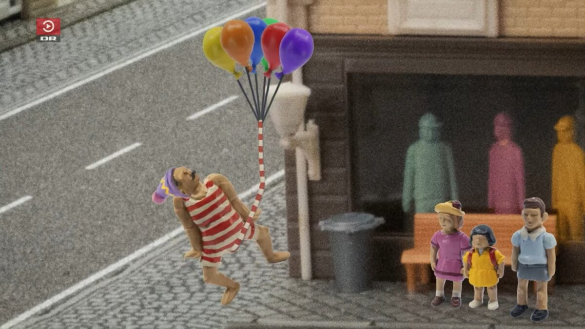 claymation man floating away with his very long penis attached to some balloons