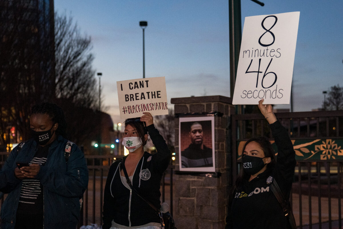 ATLANTA, GA - MARCH 08: Demonstrators hold a vigil in honor of George Floyd on March 8, 2021 in Atlanta, Georgia. Jury selection was paused today in the trial of former Minneapolis police officer Derek Chauvin, who is charged in Floyd's death. (Photo by Megan Varner/Getty Images)