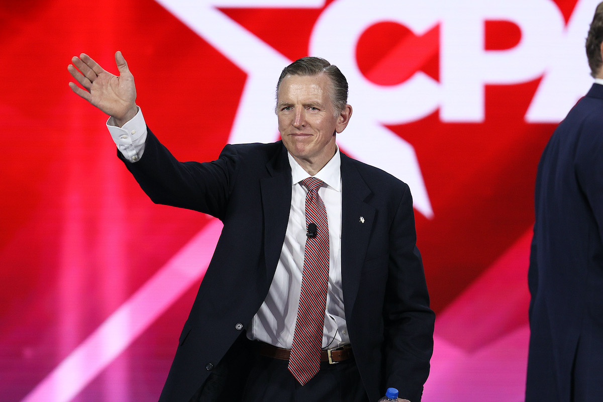 Rep. Paul Gosar waves from the stage at CPAC.