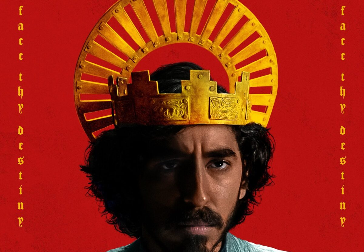 Dev Patel as Sir Gawain wears a crown in a promotional poster for The Green Knight movie