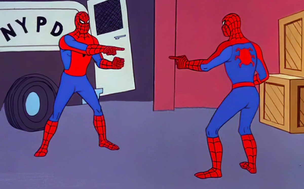 Spider-Man pointing at another Spider-Man, who is pointing back.