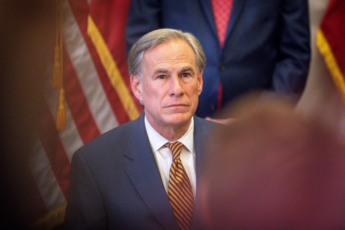 Texas Governor Greg Abbott listens during a press conference