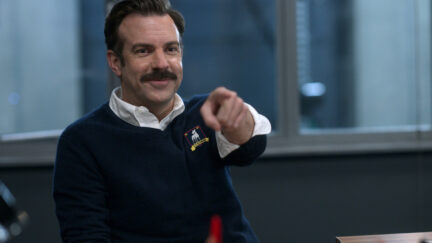 Jason Sudeikis points and smiles as Ted Lasso