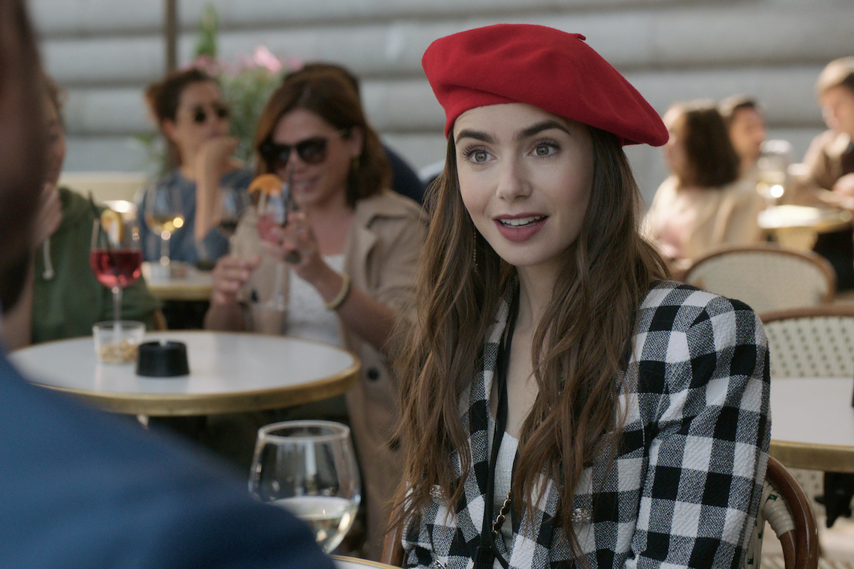 Lily Collins wears a red beret as Emily in Emily in Paris