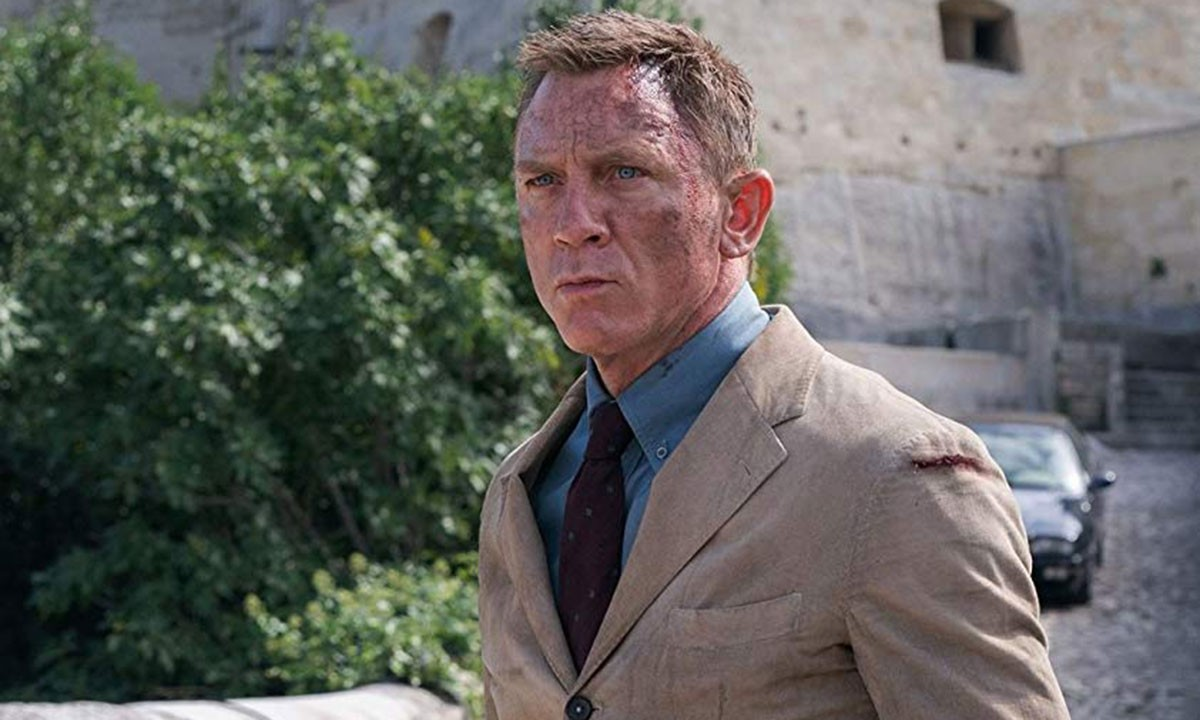 Daniel Craig with soot on his face as James Bond in the movie 'No Time To Die'